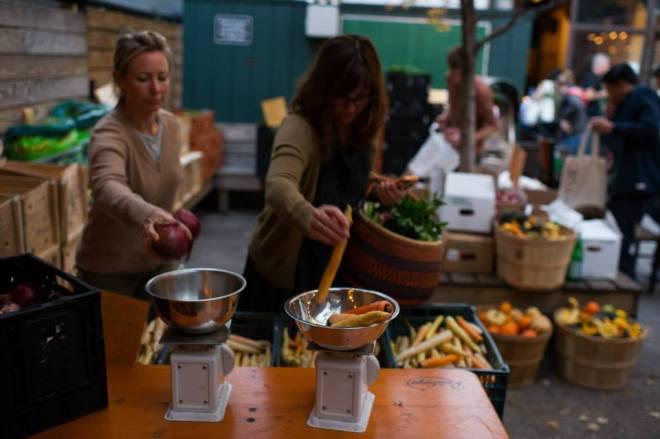 Members weighing up their vegetables