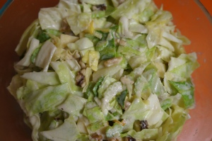 Waldorf Cabbage Slaw with apples and celery is my favorite cabbage recipe. It makes a ton- it's my favorite potluck dish.